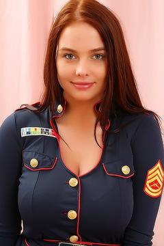 Busty Kay Pulls Down Sexy Uniform