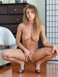 Curly Blonde MILF Rita Masturbates With A Huge Dildo 01